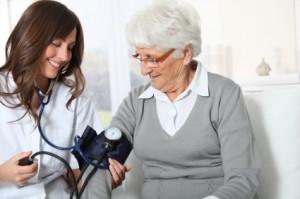 nurse taking blood pressure, nurse using stethscope, registered nurse with patient