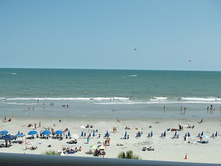 myrtle beach, save money, vacation for nurses, green ocean, people on beach